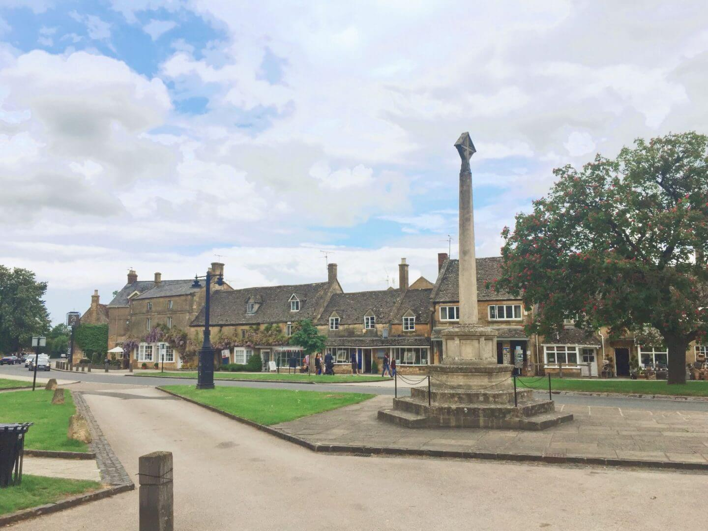 the centre of Bourton with beautiful houses and a stone memorial