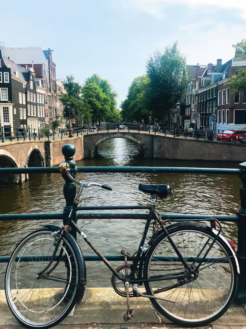 image of bike and canal in Amsterdam