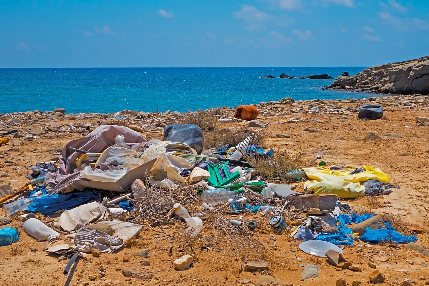 image of waste on beach - reducing waste when travelling