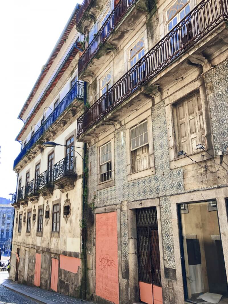 Admiring the crumbling architecture in Porto