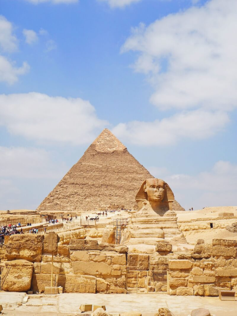 visiting pyramids of Giza and the sphinx