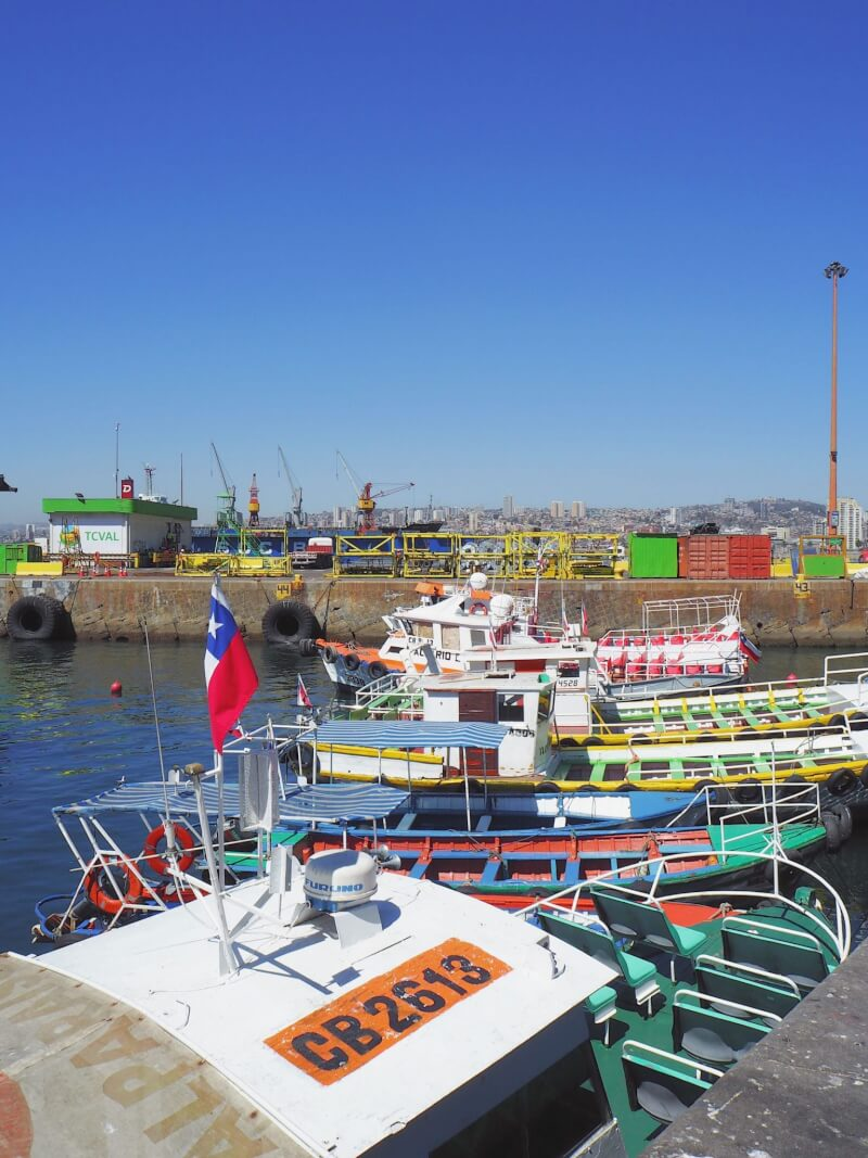 Brightly coloured fishing boats sitting in the port of Valparaiso