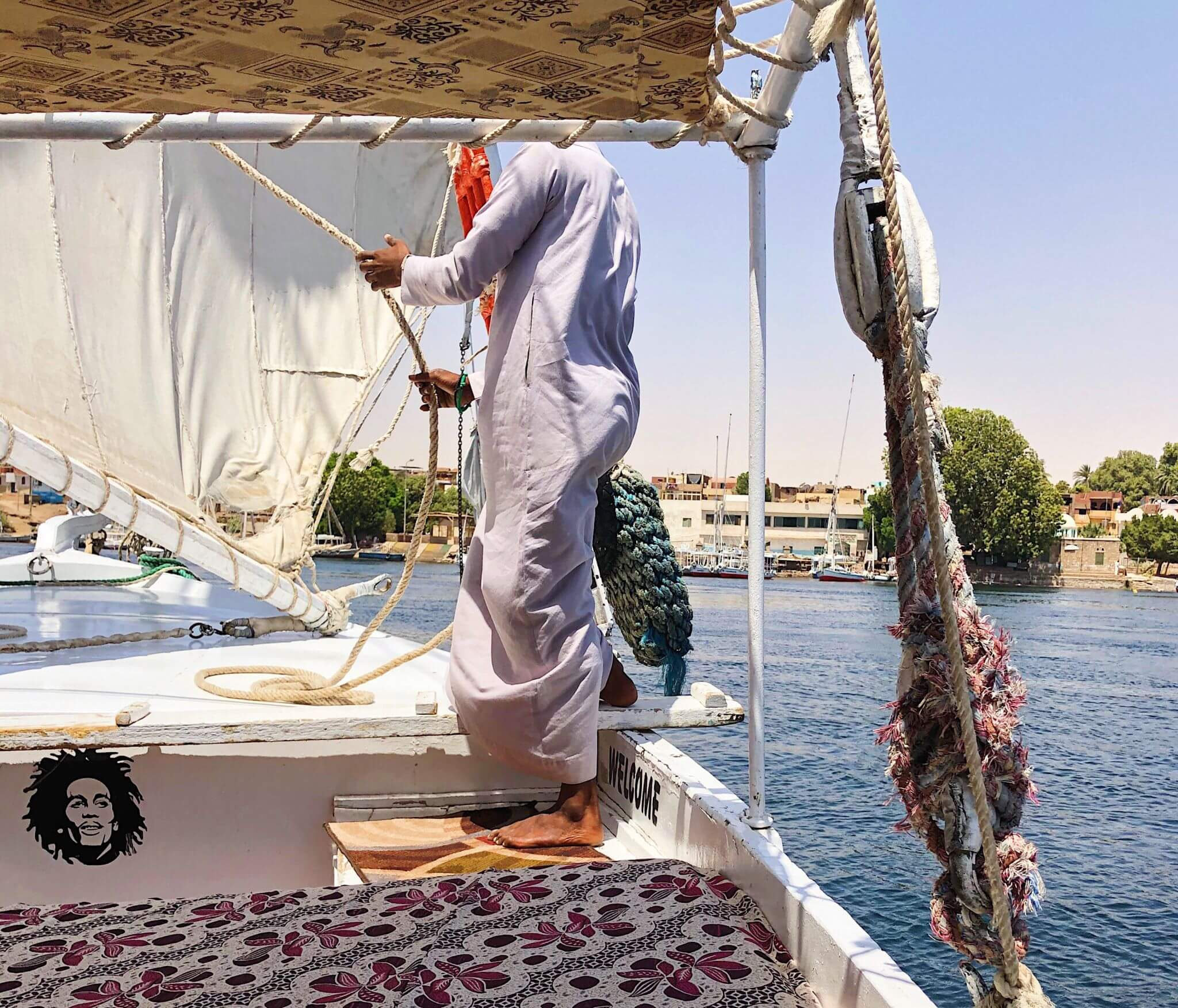 image of Nubian sailing a felucca down the Nile