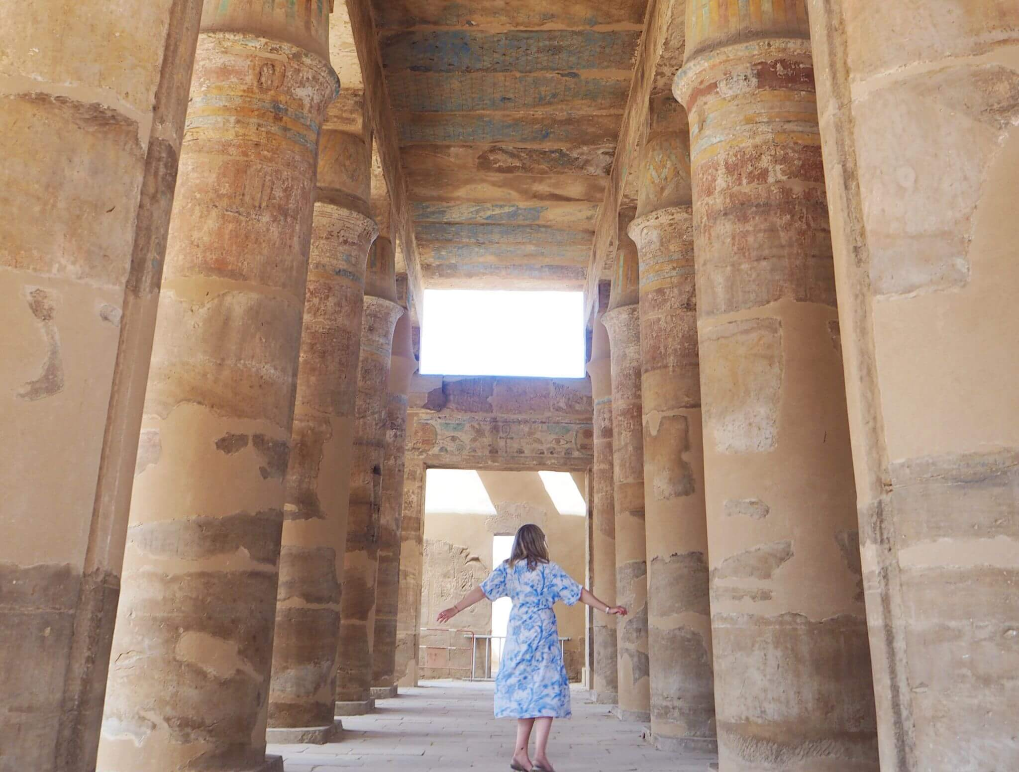 image of twirling around the columns of Karnak temple. one of the reasons you need to visit Egypt