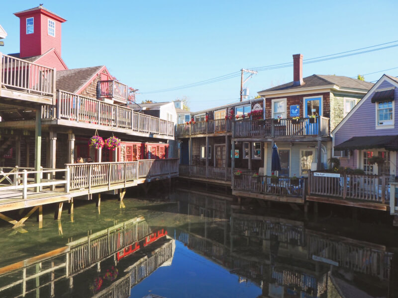 image of shops standing in the water in Kennebunkport