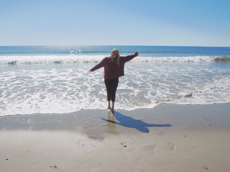 image of standing in the sea on Gooch's Beach in Kennebunkport