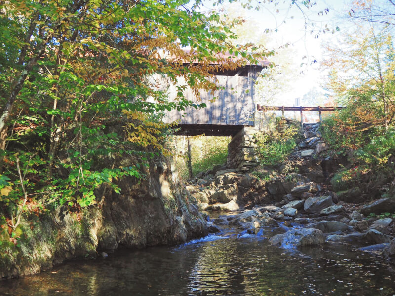 image of covered bridge in Vermont which is Gold Brook bridge in Stowe