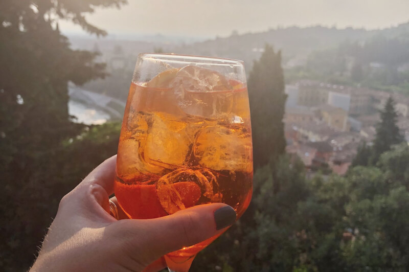image of Aperol Spritz at sunset from Castel San Pietro