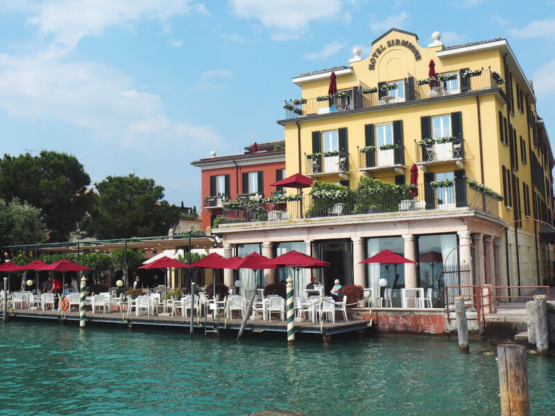 image of yellow restaurant overlooking Lake Garda