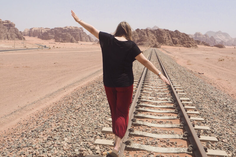 image of balancing on train tracks in Jordan
