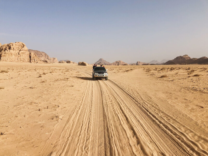 image of jeep driving through wadi Rum