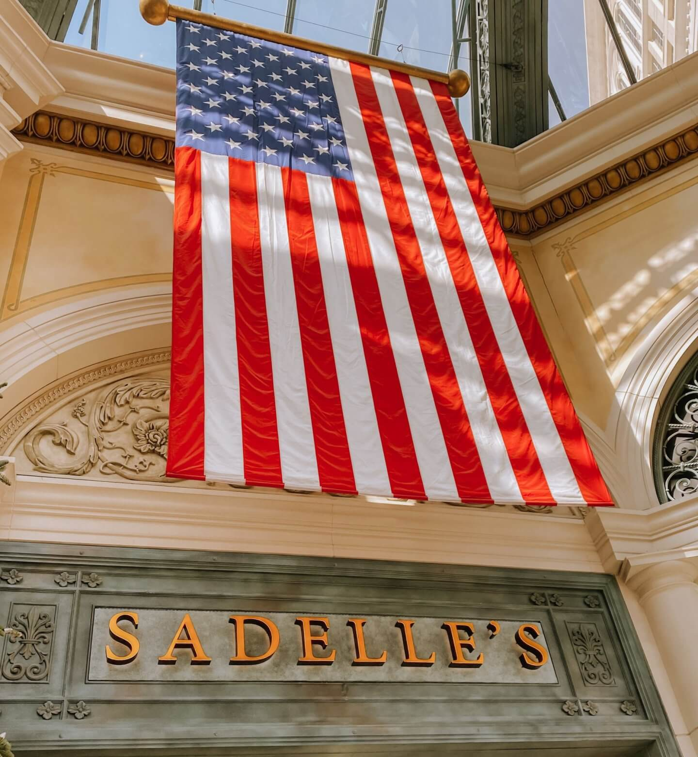 image of sadelle's sign with USA flag in las vegas